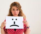 Portrait young woman with board sad emoticon face sign — Stock Photo