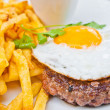 Classical english breakfast with egg and fries — Stock Photo #7208761