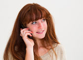 Smiling portrait young woman talk on a cellular telephone — Stock Photo