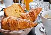 Breakfast with coffee and croissants — Stock fotografie