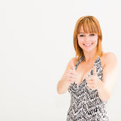 Happy woman with thumbs up — Stock Photo
