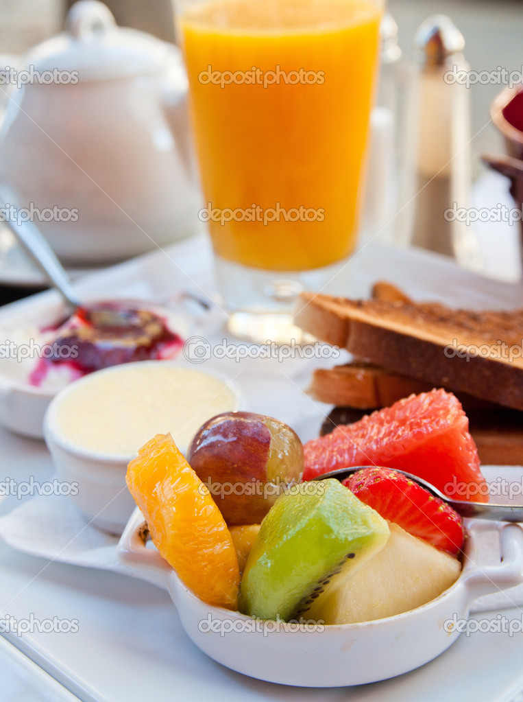 Breakfast with orange juice and fresh fruits on table  Stock Photo #7295990