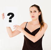 Woman with board question mark sign — Stock Photo