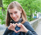 Woman make heart — Stock fotografie