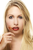 Beautiful blonde woman after eating chocolate — Stock Photo