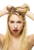 Beautiful blonde woman with chocolate covered lips — Stock Photo