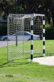 Football gates at the green grass — Stock Photo