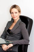Business woman at work place — Stockfoto