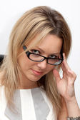 Portrait of smiling blonde woman in white blouse and glasses — Stock Photo