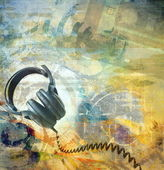 Grunge musical background with headphones — Stock Photo