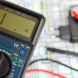 Stock Photo: Technology bacground, digital multimeter