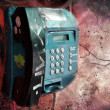 Stock Photo: Vandalized public phone