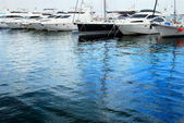 Yachts moored in harbor — Stock Photo