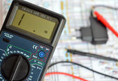 Technology bacground, digital multimeter — Stock Photo
