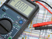 Technology background, digital multimeter — Stock Photo