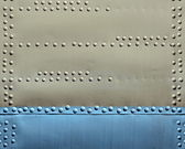 Metal texture with rivets — Stock Photo
