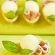Tartlets with melon, ham and basil — Stock Photo