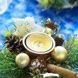 Christmas composition with candle — Stock Photo