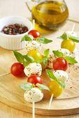 Caprese salad on wooden sticks — Stock Photo