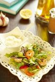Salad with shrimps, peach and grapes — Stock Photo