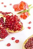 Pomegranate and flower — Stock Photo