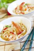 Thai spicy soup with noodles and shrimps — Stock Photo