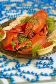 Boiled lobster with red caviar and herbs — Stock Photo