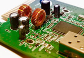 Closeup of a green electronic circuit board — Stok fotoğraf