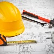 Stock Photo: Construction drafts and tools background
