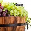 Detail of grape on old wine barrel, isolated - Stock Photo