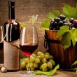 Still life with wine bottles, glasses and grapes — Stock Photo #7961095