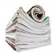 Various stacked and rolled magazines over white — Stock Photo #7961763