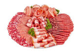 Salami ham meat and more on the plate — Stock Photo
