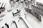 Set of chrome tools as background — Stock Photo