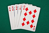 Een royal straight flush speelkaarten pokerhand — Stockfoto