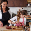 Mother and daughter baking at home — Stock Photo #7900456