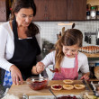Mother and daughter baking at home — Stock Photo #7900457