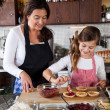 Mother and daughter baking at home — Stock Photo #7900458