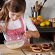 Mother and daughter baking at home — Stock Photo #7900460