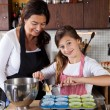 Stock Photo: Mother and daughter baking at home