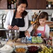 Mother and daughter baking at home — Stock Photo #7900467
