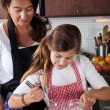 Mother and daughter baking at home — Stock Photo #7900471