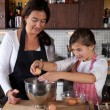 Mother and daughter baking in the kitchen — Stock Photo #7900483