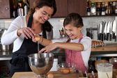 Mother and daughter baking in the kitchen — Stock Photo