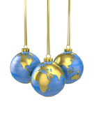 Three christmas balls shaped as globe or planet — Stock Photo