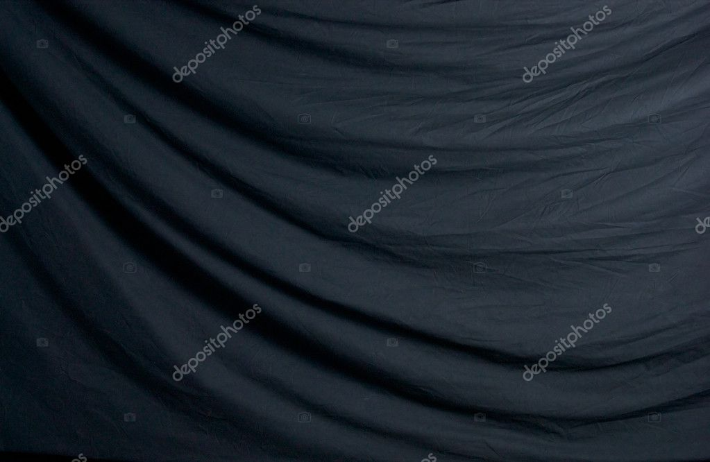 A simple draped black photographer's studio background cloth. — Stock Photo #6851738