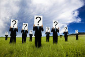 Group of businessman in black suit and holding question mark symbol — Stok fotoğraf