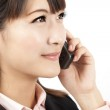 Young businesswoman talking on the mobile phone — Stock Photo