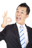 Happy Businessman giving OK gesture — Stok fotoğraf