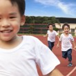 Happy kids running on the Stadium track — Stock Photo #7133937